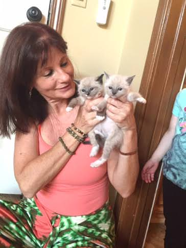 Cheri with two foster kittens. Photo via Cheri.